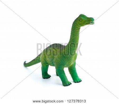 green brachiosaurus toy on a white background