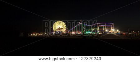Santa Monica, California -- April 24, 2016: Santa Monica Pier boardwalk lit up at night in Southern California. Editorial use.