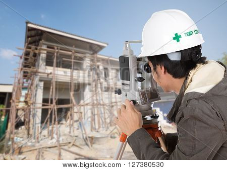 Engineers Use Tacheometer Or Theodolite With House Construction Site