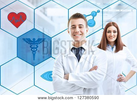Two doctors and medicine icons on background. Medical technology concept