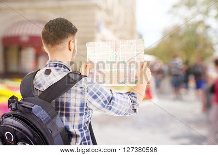 Traveler with map on the street, outdoors