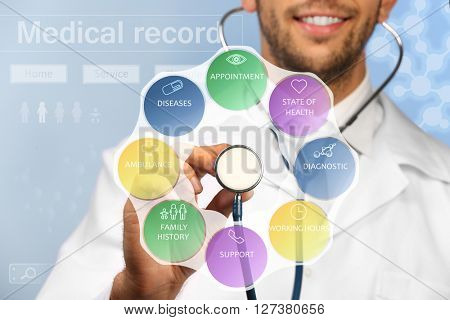 Doctor with stethoscope and medicine icons on virtual screen. Medical concept