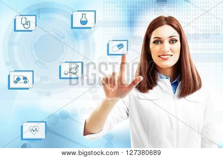 Young beautiful doctor pushing button on virtual screen. Medical technology concept