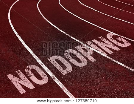 Stop doping concept. Text on running track