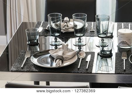 Served With A Plate On  Black Table In Modern  Dinning Room
