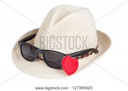 straw hat with sunglasses over white background