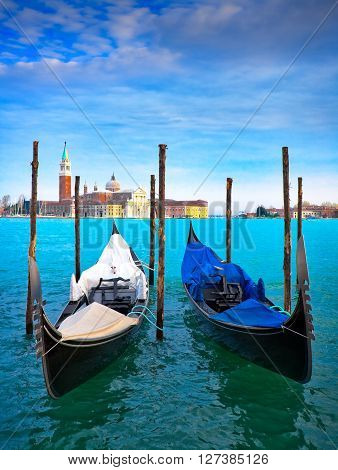 Gondolas in Venice Italy.  Venice is a city in northeast Italy which is renowned for the beauty of its setting, its architecture and its artworks. It is capital of Veneto region.