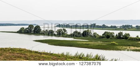 The islands of the Volga River in the quiet evening cloudy