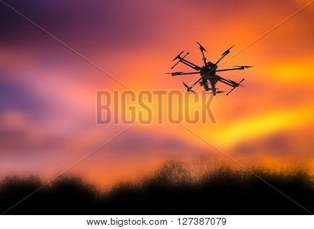 Multicopter floating in the air against a gray sky