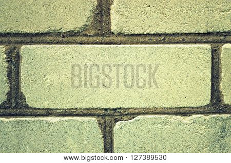 One imbedded white brick in the wall