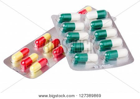 two packages with red green yellow pills on white background.