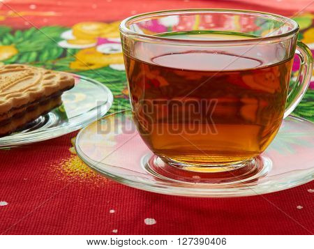 poured into a Cup of hot tea and biscuits on the saucer