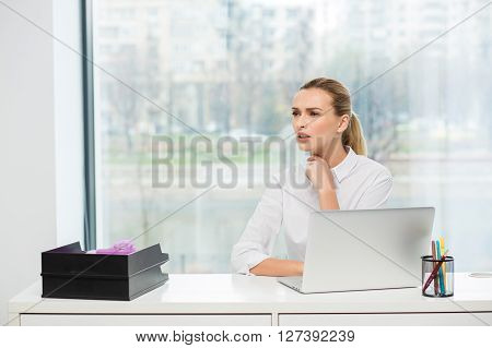Blonde Woman Behind Her Desk