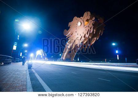 Dragon Bridge at night in Da Nang, Vietnam. Beautiful photo of modern city in night illumination.