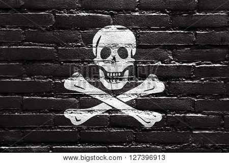 The Traditional Jolly Roger Of Piracy Flag, Painted On Brick Wall