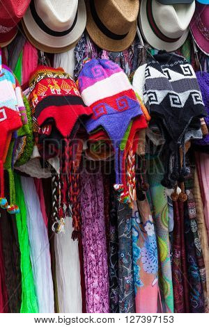 hats and scarves in a market in Peru