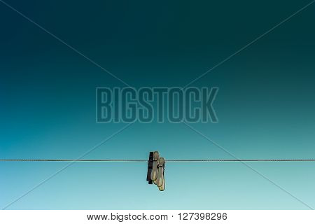 Clothes peg to hang on the line with deep blue sky behind