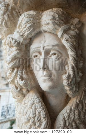 Ancient sculpture of an angel adorns the church in a mountain monastery in Crimea