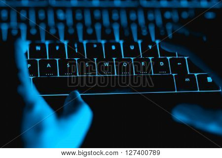 Hacker Typing On The Illuminated  Keyboard By Night.