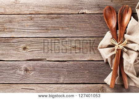 Kitchen utensil over wooden table background. View from above with copy space