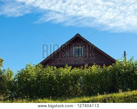 Wooden country house on a background of clear sky