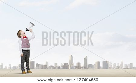 Kid boy with megaphone