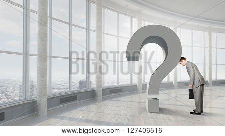Businessman in despair to find answer