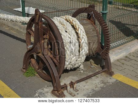 Old winch on seafront in Funchal Madeira Portugal