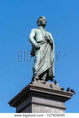 Statue of Adam Mickiewicz, Polish national romatic poet and dramatist on Main Market Square in Krakow Poland.