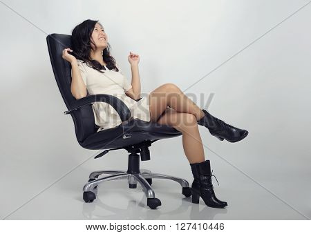 Asian girl sitting on chair