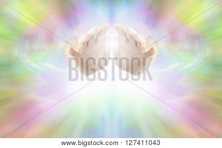 Life Force Healing Energy - female hands emerging from vibrant rainbow colored energy field with white light beneath and plenty of copy space
