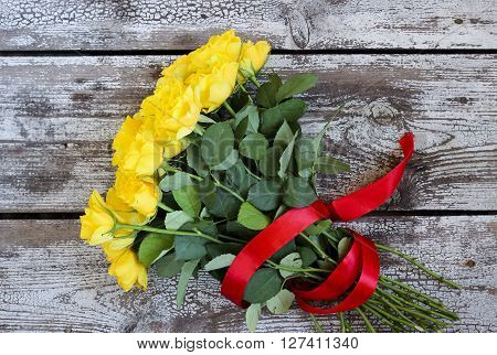 Bouquet Of Yellow Roses With Red Ribbon