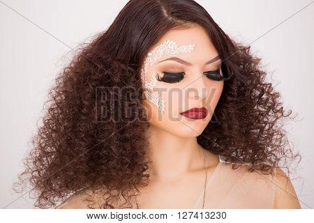 Fake long eyelashes and afro hairstyle portrait shot
