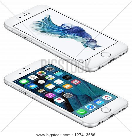 Varna Bulgaria - October 25 2015: Silver Apple iPhone 6S lies on the surface with iOS 9 mobile operating system and Siamese Fighting Fish Dynamic Wallpaper on the screen. Isolated on white.