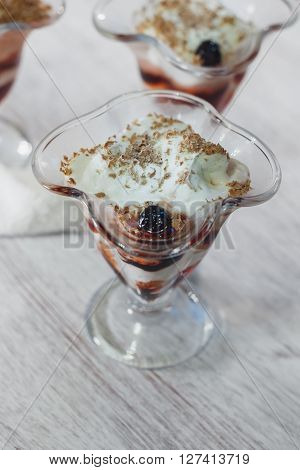 Delicious vanilla parfait with jam and chocolate
