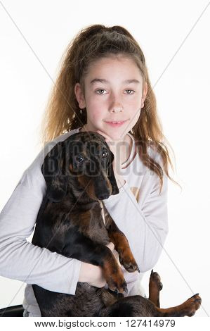 Portrait Of A Beautiful Young Girl Snuggling With A Cute Dog, Isolated On White In Studio