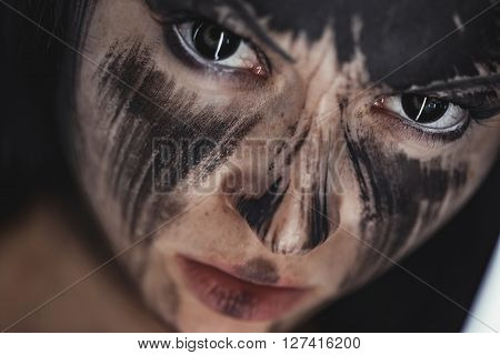 Scary portrait of the woman. Demon theme on Halloween