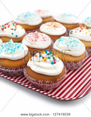 colorful cupcakes with sprinkles on a tray
