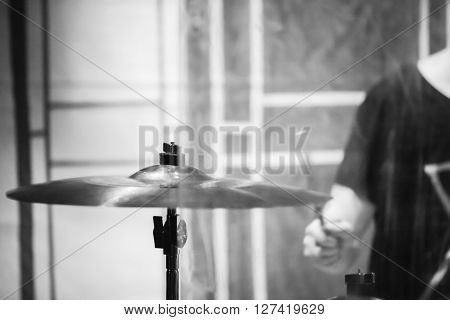 Drummer Plays On Cymbal. Black And White