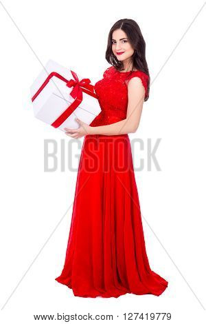 Full Length Portrait Of Cheerful Woman In Red Dress With Big Gift Box Isolated On White