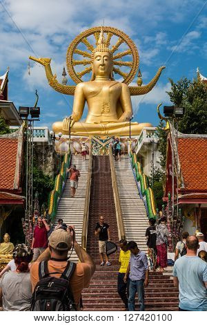 KOH SAMUI THAILAND - JAN 23 2016 : Big buddha with many of tourist in the temple on January 23 2016 . One of the most famous landmark of Koh Samui Surat Thani Province Thailand