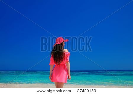 Brunette Woman Enjoyng On Tropical Beach. Attractive Girl In Red Hat And Dress Resting, Outdoor Port