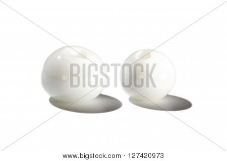 Hand made white glass beads on white background