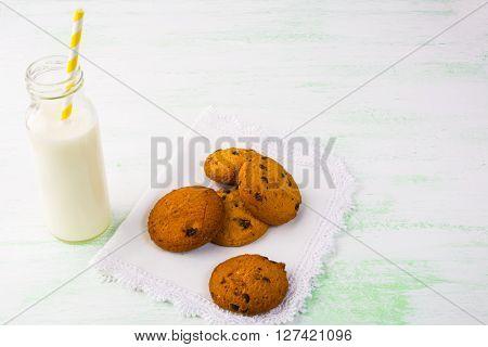 Milk bottle with straw and homemade cookies. Breakfast cookies. Sweet pastry. Sweet dessert. Homemade cookies