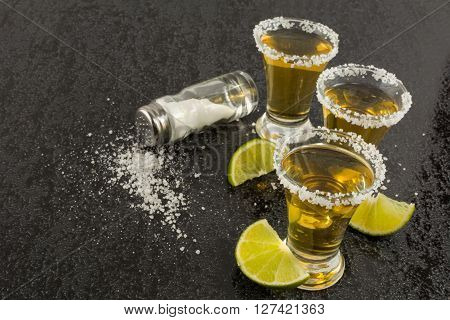 Tequila shots with lime and salt. Tequila. Tequila shot. Gold Mexican tequila
