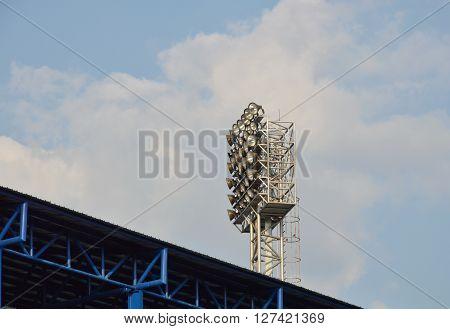 football stadium light pole on sunny day