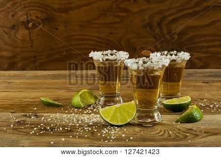Two gold tequila shots copy space. Tequila shot. Gold Mexican tequila. Tequila. Alcohol drink