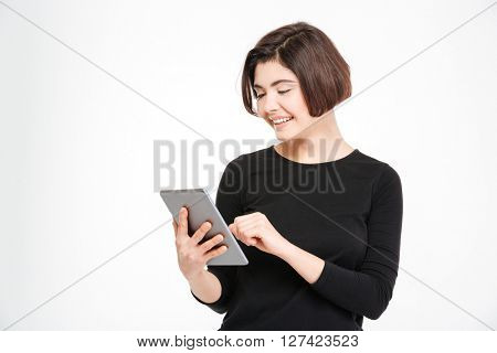 Smiling woman using tablet computer isolated on a white background