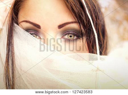 Closeup portrait of a woman covered with veil