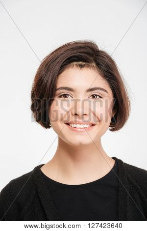 Smiling casual woman looking at camera isolated on a white background